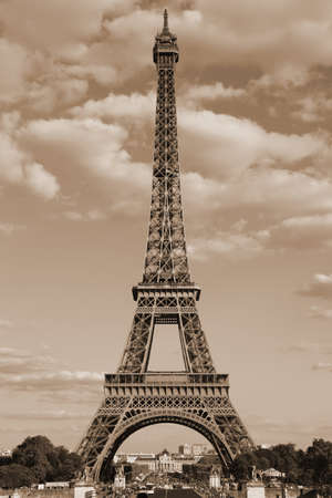 eiffel tower symbol of the city of paris with Sepia Toned effect and the clouds in the sky