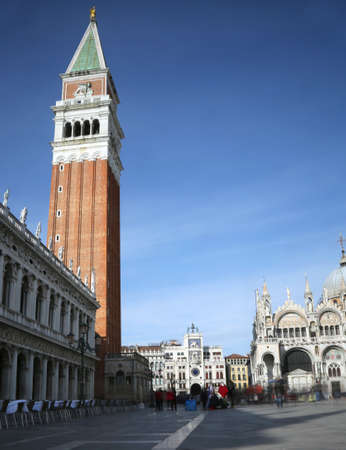 bell tower of Saint Mark in Venice in Italy and the movement of the people created with the technique of the long photographic exposure