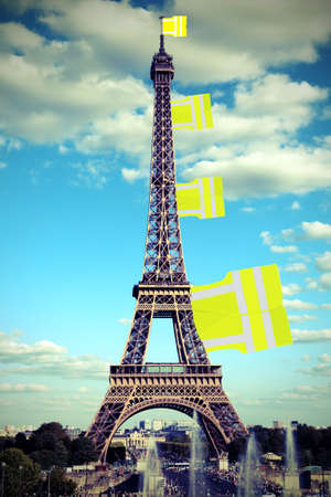 Big flag like a jackets symbol of Yellow vests movement on Eiffel Tower in Paris seen from the Trocadero and old toned effect