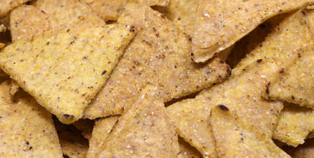 background of many triangles of Tortillas chips a very good salty snack