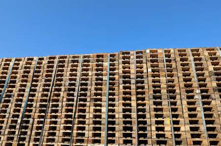 many pallets without people and blue sky Standard-Bild