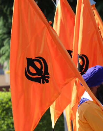 big orange flag and symbol of SIKH religion Stock Photo