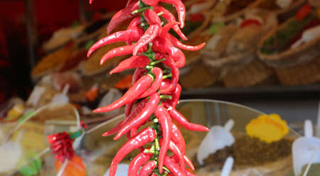 many spicy red chillies for sale in the outdoor market stall 写真素材