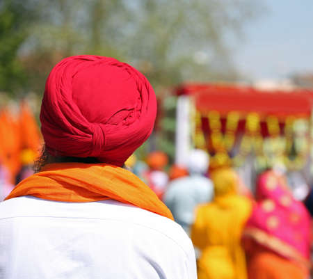 Sikh man with red turban and white shirt Stock Photo