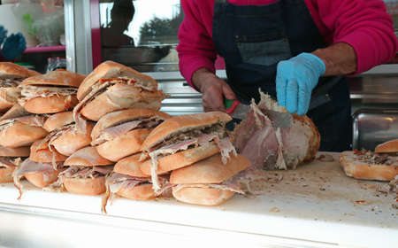 sandwiches with roasted pork for sale at kiosk of street food