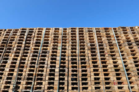 background of many pallets and blue sky