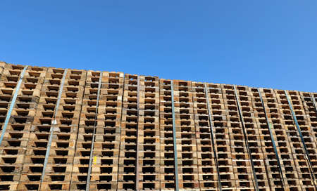 many wooden pallets for the transport of the goods and blue sky