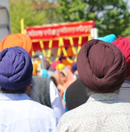 turbaned men during religious rite on sikh religion
