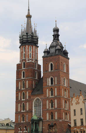 Krakow in Poland and the Church of Our Lady Saint Mary with two bell towers