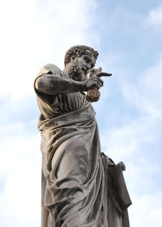ancient great Statue of Saint Peter with long beard and the keys in in the great square of Vatican city