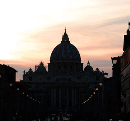 black silhouette of the great dome of Saint Peter Basilica in the Vatican City from Road of Conciliazione in Rome Italy