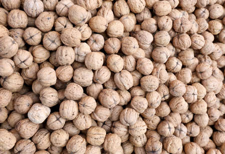 background of many nuts with brown shell grown with organic techniques without chemical treatments