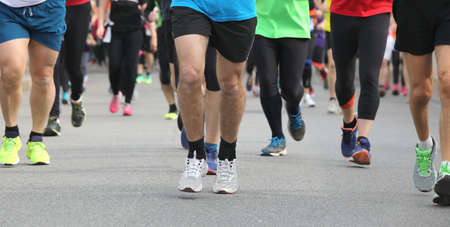 Legs of runners at marathon race in the city