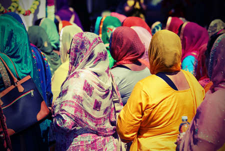 many sikh women and girl with veil during a religion parade