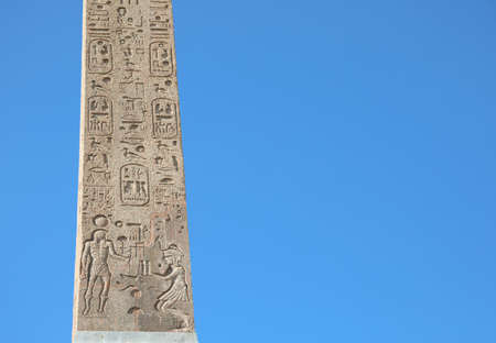 Ancient Egyptian obelisk with many symbols called hieroglyphics that were the writing system of the ancient Egyptians