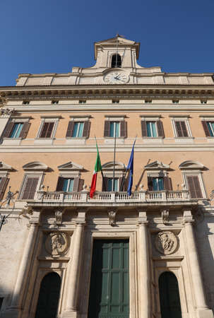 Entrance to the Montecitorio Palace in Rome Italy  headquarter of the Italian Parliament with flags