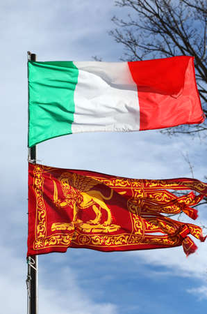 Italian flag and the Flag of Veneto Region with winged Lion