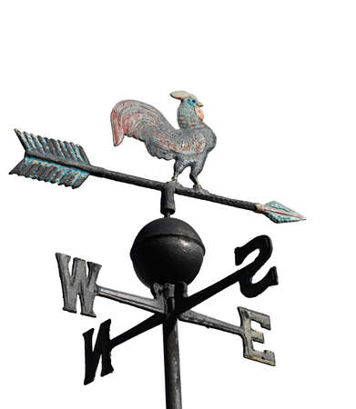 old wind weather vane with cock on top and cardinal points on white background
