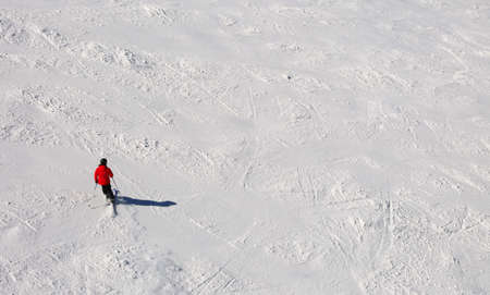 skier in the slope in the white snow in mountain 写真素材
