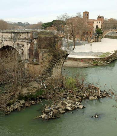 Old broken bridge called Pons Aemilius in Rome Italy