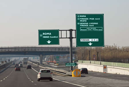 road junction in the italian motorway and indication to ROME FLORENCE and more italian place Stock Photo - 120353756