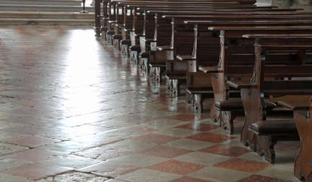 Empty church bench also called wooden pew without people