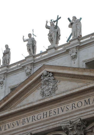 big statue of Jesus and other Saints on the Saint Peter Basilica in Vatican City Stock Photo