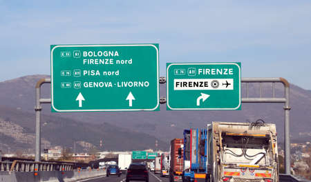 Italian motorway with many indications to main cities such as Bologna, Florence, Pisa or Genoa Archivio Fotografico - 120406990