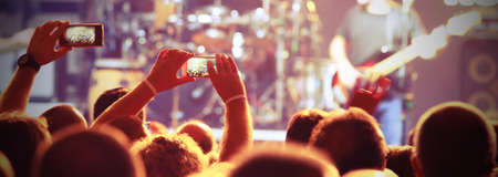many people at live concert with smart phones near the stage Stock Photo