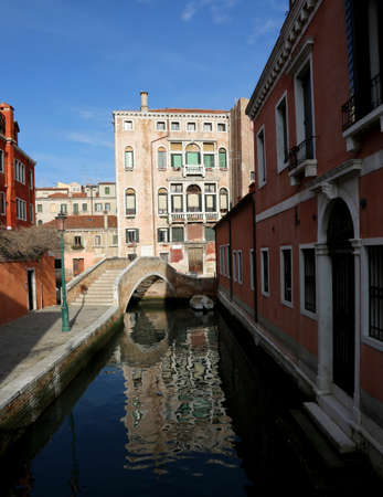 Ancient Palace and the old brdige over the navigable waterway in Venice Italy