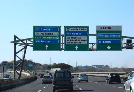 road junction in the italian highway called GRA and indications to ROME and other italian place Stock Photo