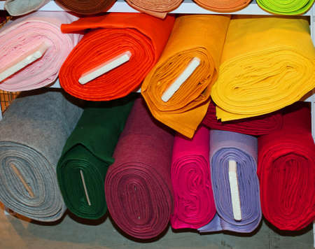 colorful fabric rolls on the shelves of haberdashery