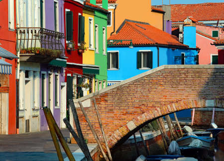 Burano isalnd near Venice in Italy  and vivid color painted houses and a pedestrian old bridge
