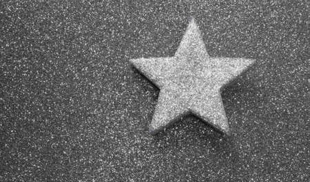 silver star on glitter material on grey shiny Imagens