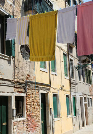 clothes hanging in the street called Calle in Venice italy