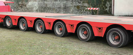long blue truck with six pairs of wheels for exceptional transport