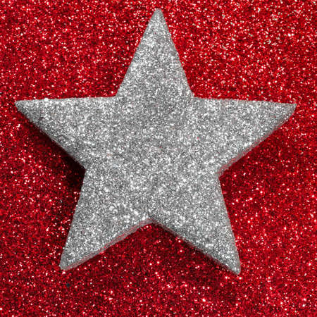 very big shape of silver star red background