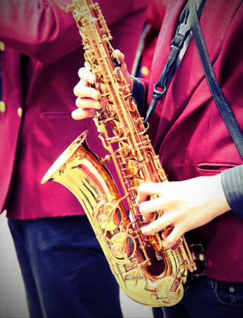 young player plays the saxophone with old toned effect
