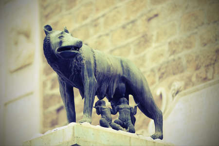 she-wolf called LUPA CAPITOLINA in Rome in Italy with Remus and Romulus children with old toned effect Editorial