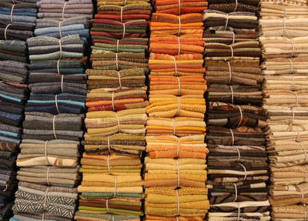 pieces of fine cotton fabrics for sale in a haberdashery shop