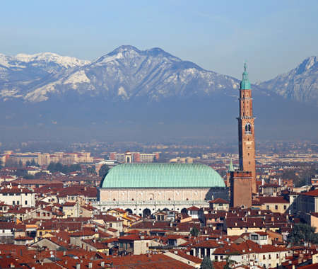 houses and the historic monument called BASILICA PALLADIANA in Vicenza City in Italy