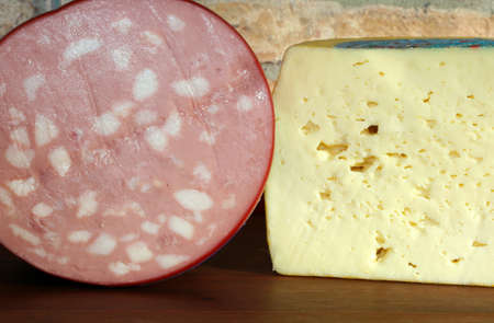 Italian cheese and mortadella in food store