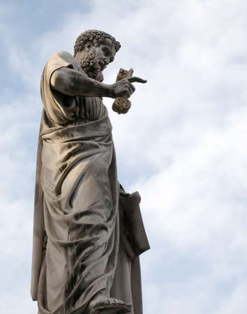 statue of Saint Peter with keys on the hand in the main square of the Vatican City Editorial