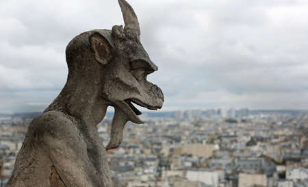 gargoyle the mythical winged monster on the cathedral of Notre Dame in Paris Stockfoto