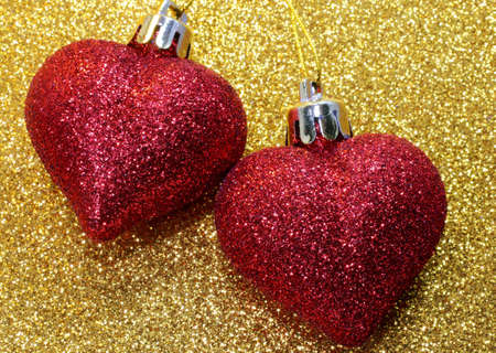 two big red hearts on golden background