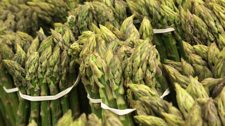 background bundles of green cultivated asparagus for sale