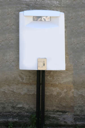 white mailbox of a Postal Service in the european city