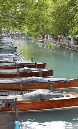 many moored boats in the navigable canal in Annecy City France in summer