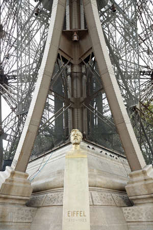 bust of Gustave Eiffel a civil engineer bottom his famous tower in Paris France Stock Photo