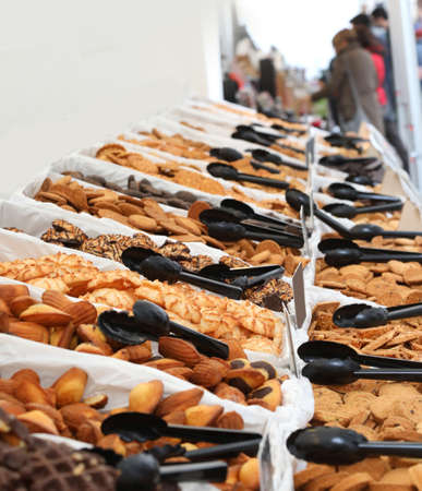 stall in the market with many cookies and black spoons Archivio Fotografico
